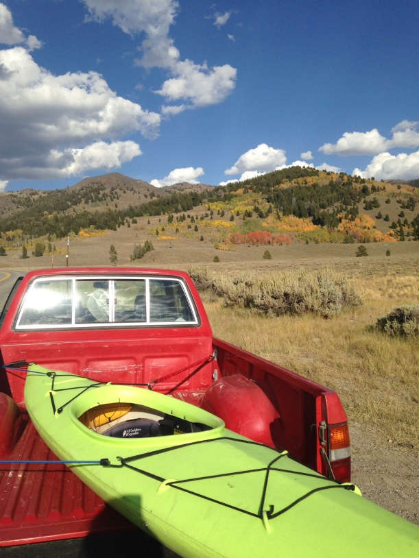 The little red truck with kayak on the way home