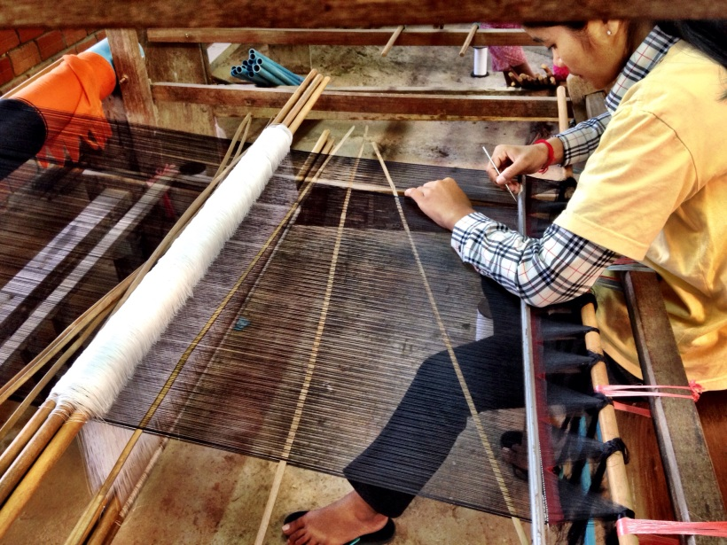 The threads are counted and tied to prevent the dye from soaking in. This creates spools with patterns.