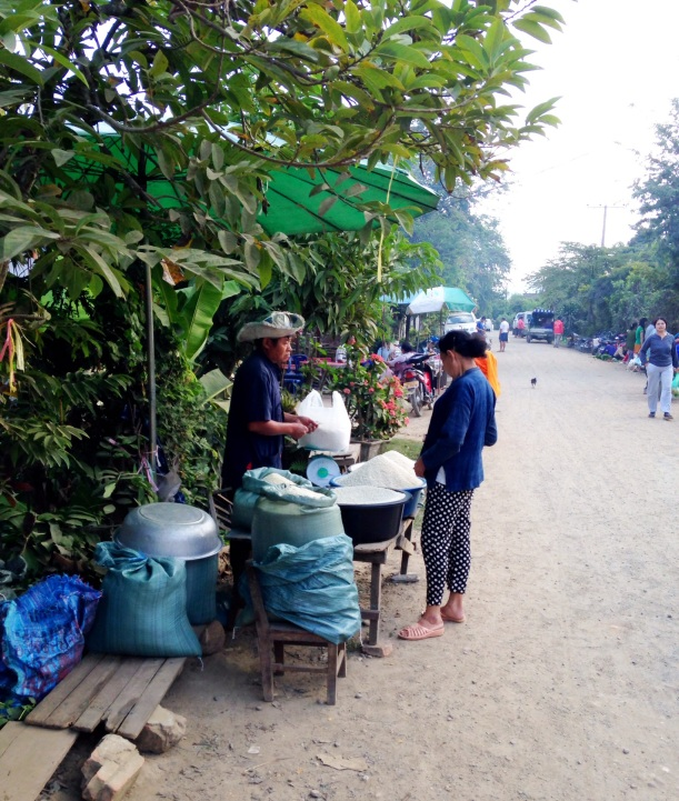 Selling rice at the morning market