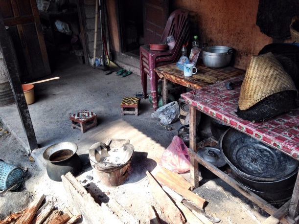 Typical porch in Laos, small seats, everyone sits in a circle and shares food and a pot for cooking rice