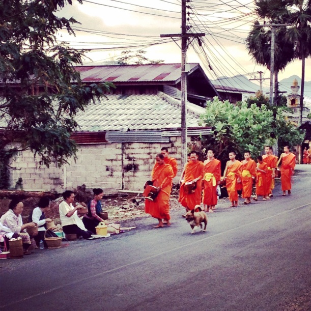 Offering rice to the monks in Laos
