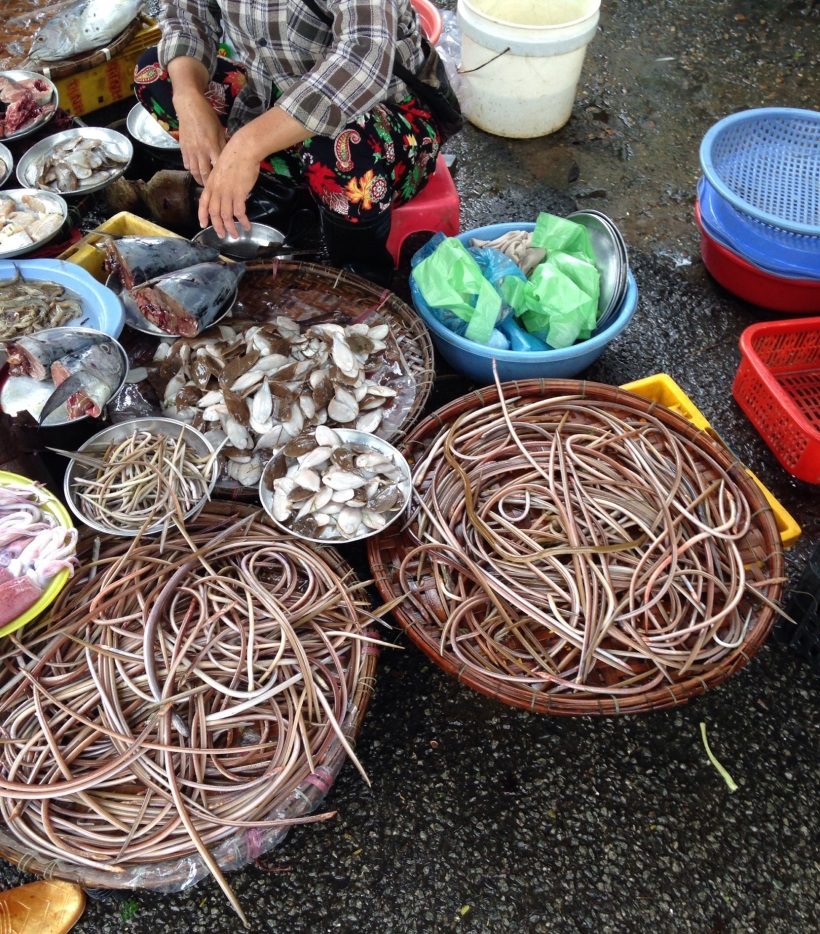 I had to look closely to see that these were baskets full of eels for sale, maybe they are tasty? Maybe they are not so ugly after all.