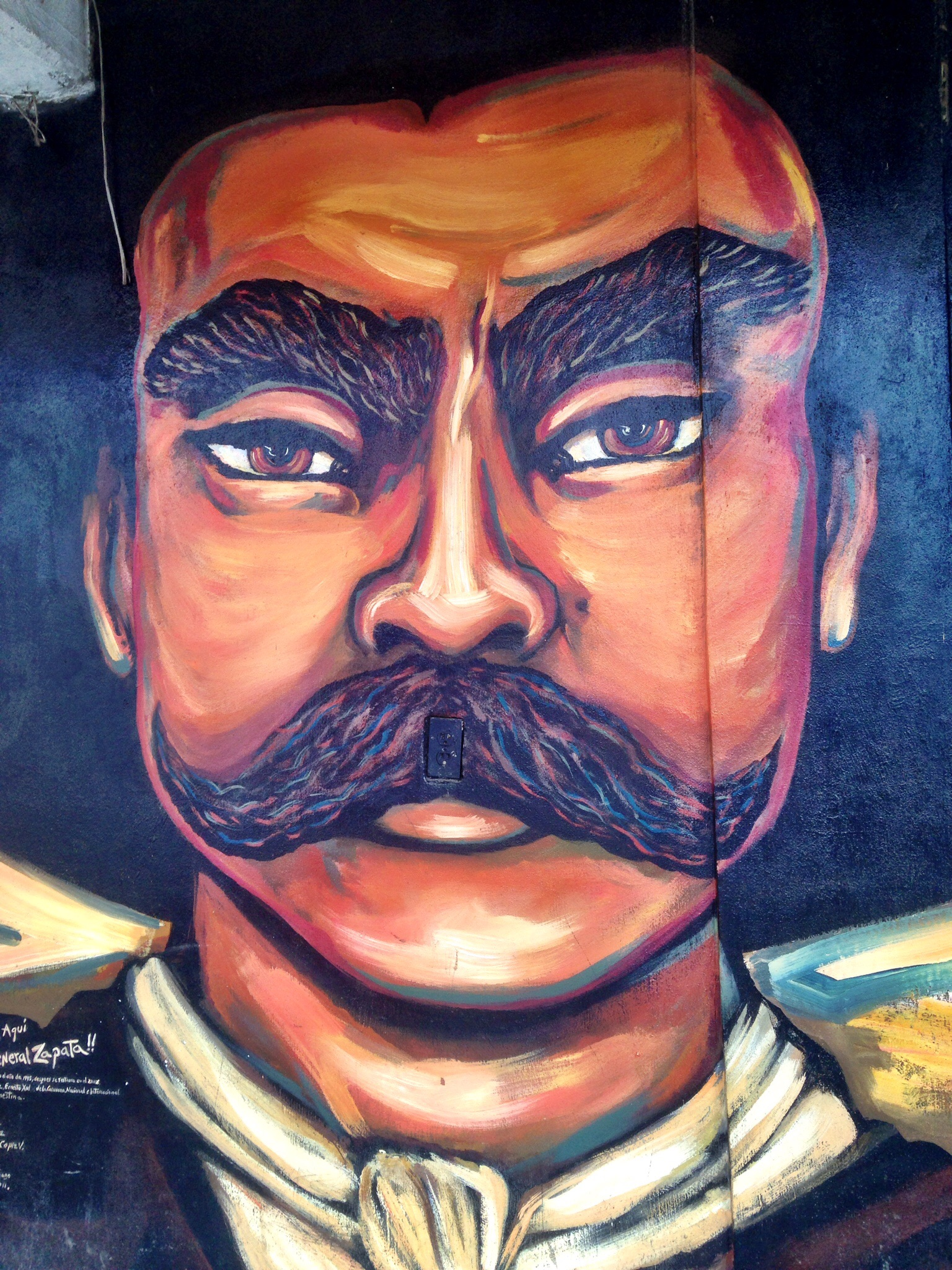A visit to a zapatista community oventic e2 travel for Emiliano zapata mural
