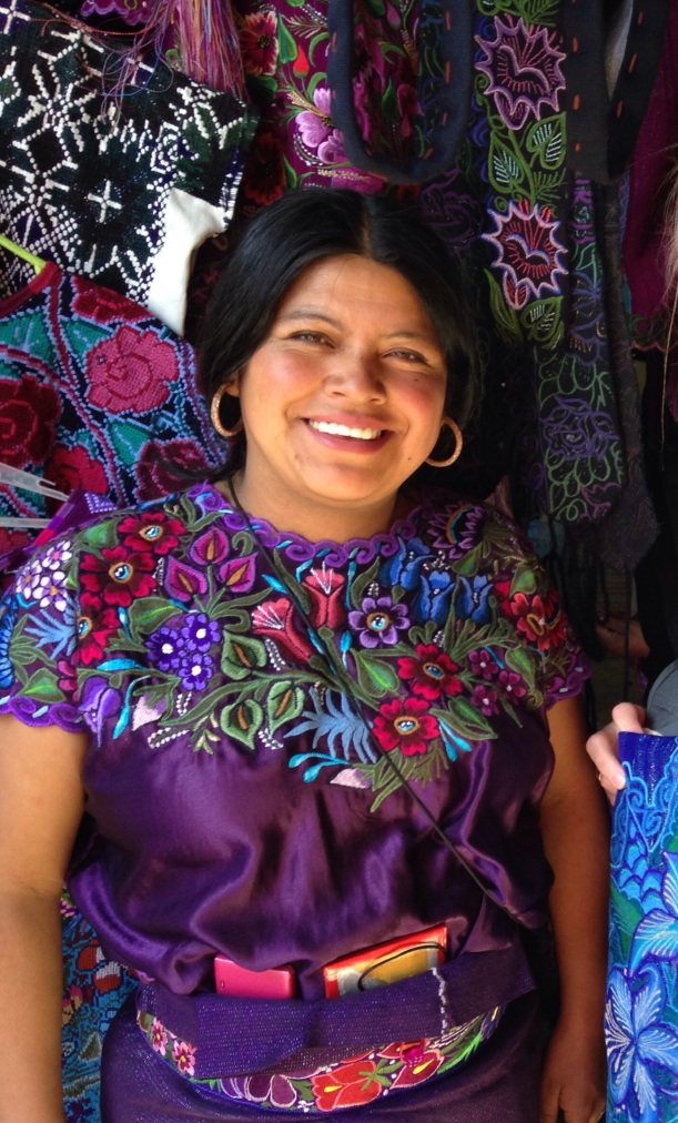 Not only do the people of Zinacantan grow flowers, but the women wear them.