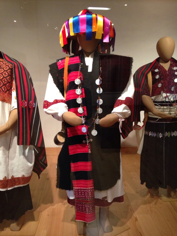While visiting the town of Tenejapa, we were welcomed to enjoy an amazing spectacle of worship inside the church. The men were wearing the clothing pictured. Taking pictures of religious ceremonies is a sign of disrespect. This photo is from the museum.